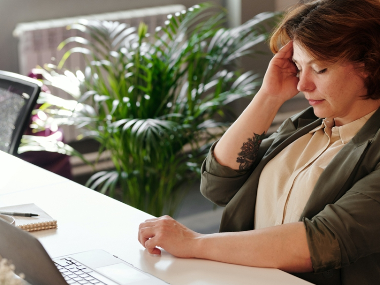 woman-holding-her-head-stressed