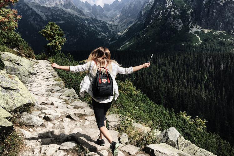 lady-running-mountainside-750-500